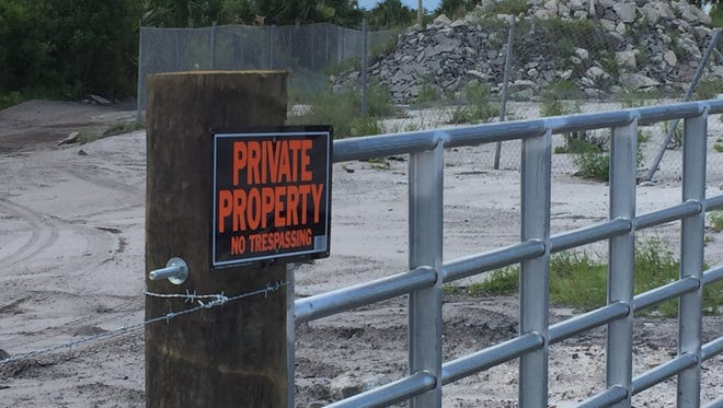 A fence and gate were erected, and no trespassing signs posted around property at the end of Deering Parkways