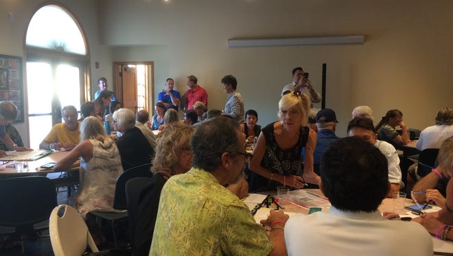 About 100 people -- mostly artists -- filled the community room at the La Quinta Museum on Wednesday for a public meeting to discuss new art programs following the cancellation of Art Under the Umbrellas.