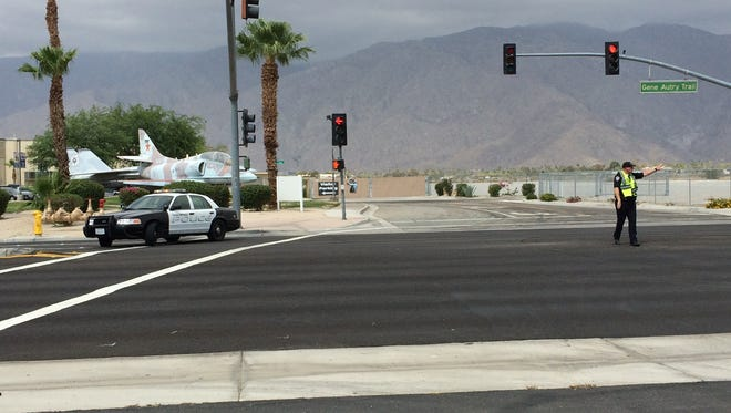 A Palm Springs police officer blocks traffic on Gene Autry Trail at Tamarisk Road. Southbound lanes were blocked after a car crashed north of Ramon Road.