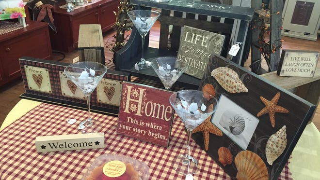 Country-style decor, glassware and (of course) candles are displayed at Home Style Candle Company.