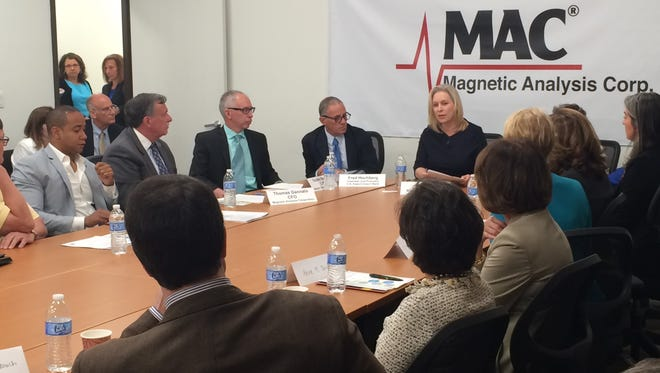 Sen. Kirsten Gillibrand, center, participates in a roundtable discussion with Fred Hochberg, the head of the Export-Import Bank, U.S Rep. Nita Lowey and business community leaders in Westchester at Magnetic Analysis Corporation in Elmsford.