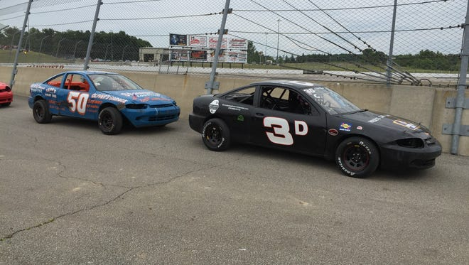 Stock cars get ready to enter the track during Sunday's Freedom Fest at Spitzer Motor Speedway.