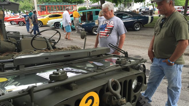 Scott Bristley shows off his 1945 Willy's MB Jeep to David Ehrnsberger. The MB features a 30 caliber machine gun with attached floating trailer used to transport artillery.