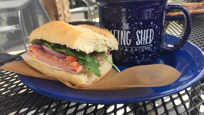 The half sandwich combo lets diners chose any sandwich and a half salad or cup of soup. Pictured are the Italian Deli sandwich and a cup of Barrel House Beer Cheese Soup.