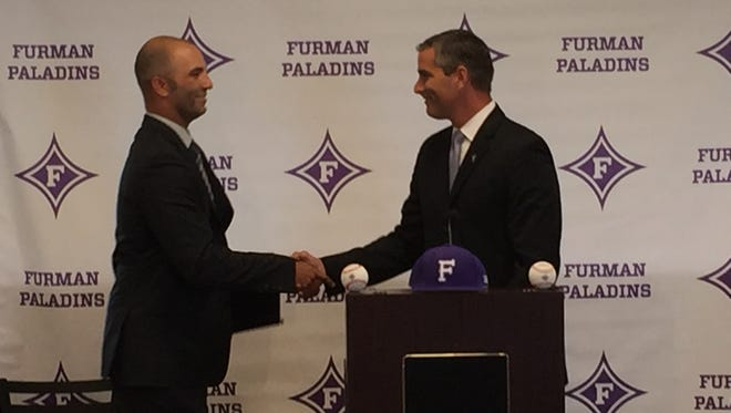 Furman athletic director Mike Buddie, right, introduces new baseball coach Brett Harker.