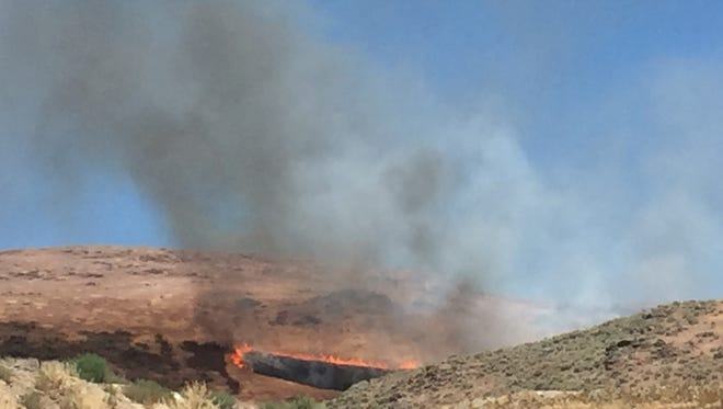 A wildfire began burning before 2 p.m. Wednesday near Vista Boulevard and Loop Road in east Sparks.