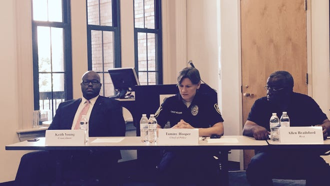 Asheville Police Chief Tammy Hooper addressed community concerns at the Citizens Police Advisory Committee meeting Thursday. To her right is city councilman Keith Young. To her left is committee member Allen Brailsford.