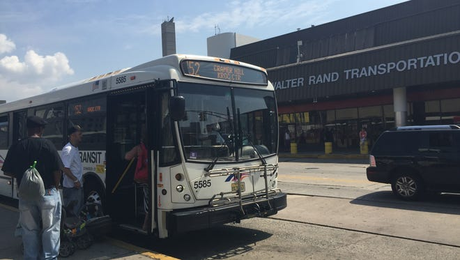 Passengers board a New Jersey Transit bus outside the Walter Rand Transportation Center in Camden. The station is slated for a redesign by Camden County with money from a regional planning agency.