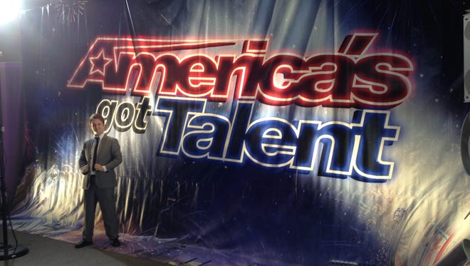 Daniel Joyner stands in front of the 'America's Got Talent' sign in Los Angeles.