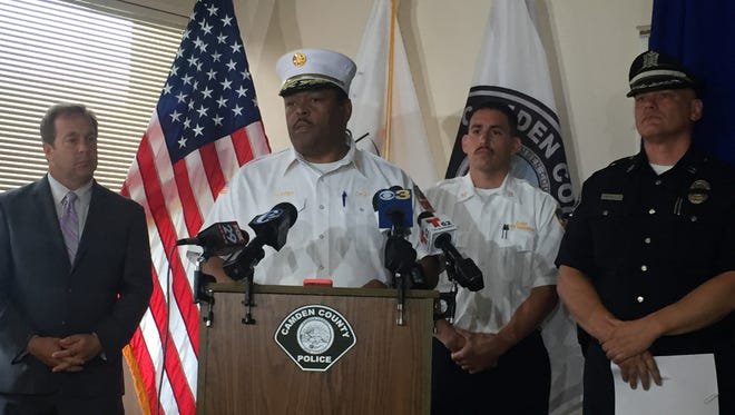 Camden Fire Dept. Chief Michael Harper (center) talks about the arrest of Charles E. Ricks Jr., charged with setting a series of fires in the city last weekend.
