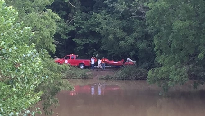 The Montgomery County Water Rescue Squad searches Ringgold Creek for a man who fell into the water on post at Fort Campbell on Friday evening.