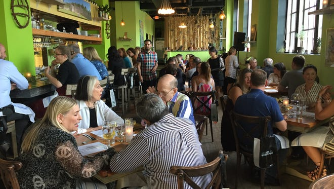 Full house at Charteuse restaurant during the Detroit Free Press Top 10 Takeover in Detroit on Monday, July 11, 2016.