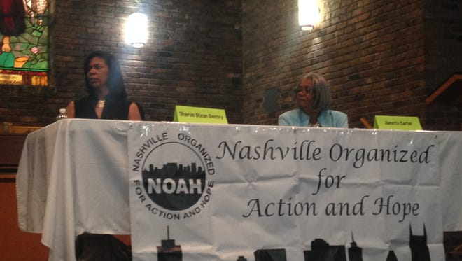 Sharon Gentry and Janette Carter prepare for the NOAH forum.