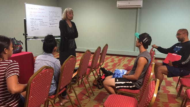 Sue Gozansky, a longtime volleyball coach, speaks to athletes at the Wyndham Garden Guam on June 30 about how to get into college volleyball programs  .