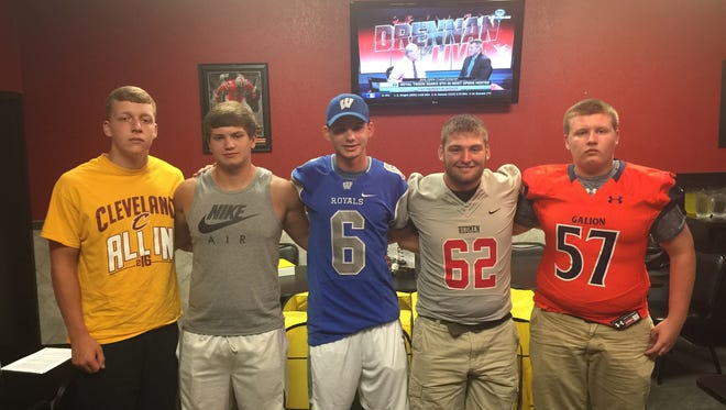 Wynford's Tyler Glowaski (Center #6) enlisted the help of (left to right) Jacob Faulkner, Cameron Spangler, Zackary Patterson (62) and GabeMakeever in his Teams for Tots community service project.