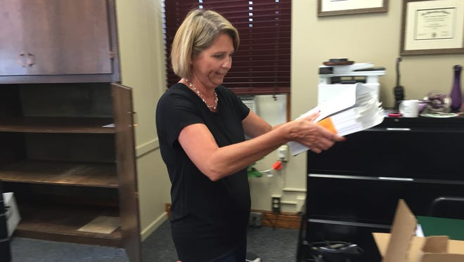 Sandusky County Auditor Jerri Miller prepares to move to temporary offices at Terra State Community College as renovations are set to begin at the Sandusky County Courthouse.