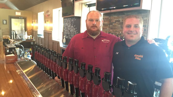 Jay Nichols, left, and Tony Caraglio, business partners at the Stoneyard American Craft Beer Hall in Penfield.