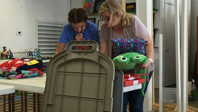 Cassidy Thomas, left, and JoAnn Ward set up displays for sewing on Thursday, July 14, 2016 in the Home Ec building at the Tippecanoe County Fair Grounds.