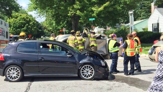 Port Huron police and firefighters respond to a three-car crash on July 14 at Electric and 11th.