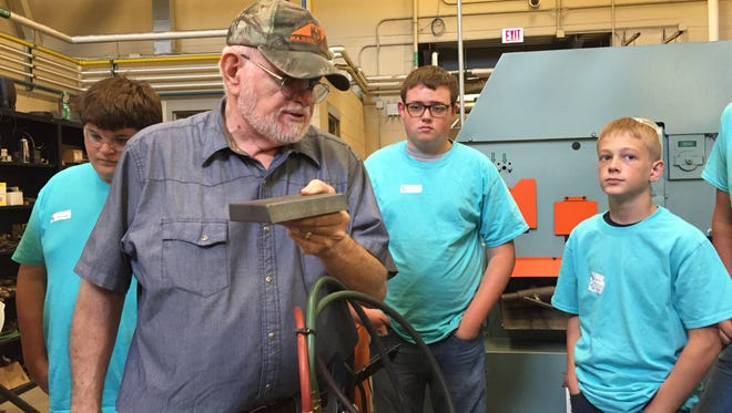 Welding instructor Bill McCleese shows students some welding tools during a class at Terra State Community College.