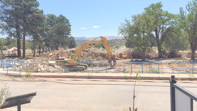 An excavator stands where the west wing of the old Fort Bayard Hospital used to be. The entire hospital has been demolished.