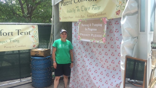 Sky Yeasayer helped manage The Diaper Fairy's Comfort Tent at Forecastle Sunday.