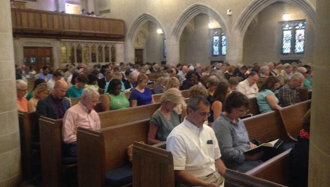 Congregations gather at First United Methodist Church in Cloverdale Sunday night for a prayer of peace following the Baton Rouge shooting.