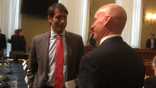 Rep. Garret Graves, R-La., (left) talks to a witness at a congressional hearing. Graves is not attending the GOP convention because of the police shootings in Baton Rouge