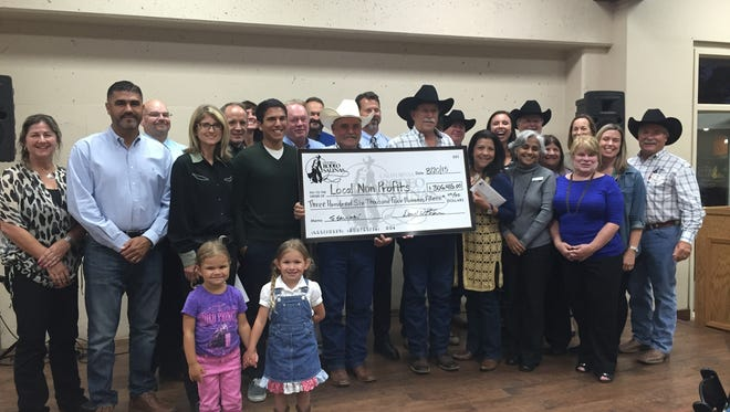 Representatives of the California Rodeo Association present a check for more than $300,000 to area nonprofits in October.