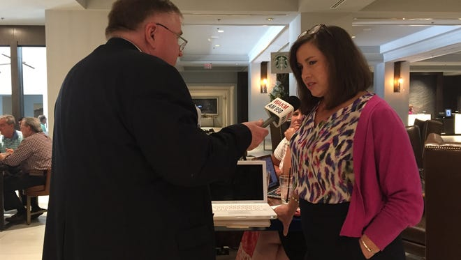 State House candidate Holly McCall, right, talks to Tom Lawrence of WAKM AM-950.