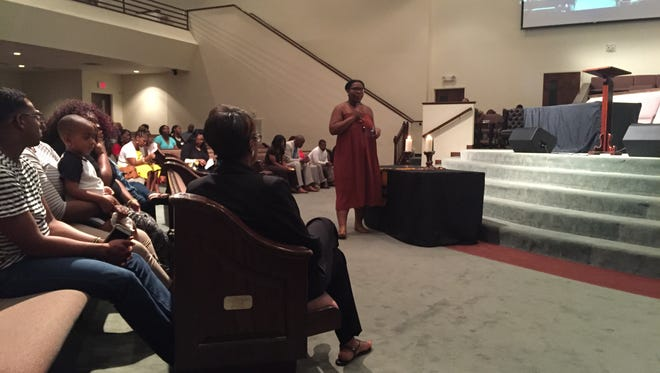 Black Lives Matter Nashville activist Rhiana Anthony asks everyone to scream at the Watson Grove Church Grief and Healing event July 19, 2016.