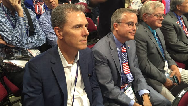 Delaware Republican Party Chairman Charlie Copeland (left) joins other Delaware delegates in listening to a speaker at the Republican National Convention Wednesday night in Cleveland.