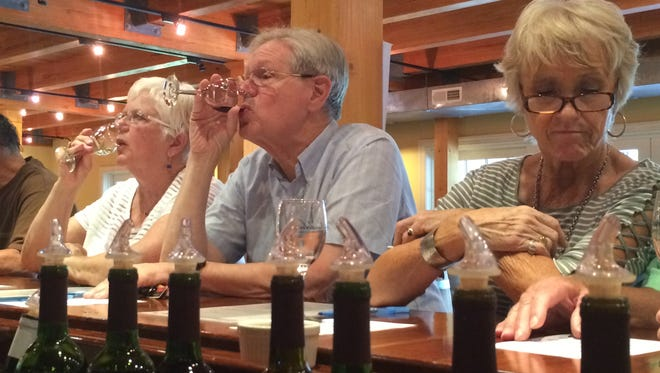 """(From left) Debbie and Steve Druck and Mary Ellen Craig tasted samples at Bordeleau Winery. Although she lives in Ocean Pines, it was the first visit to the winery for Craig and her boyfriend, John Cabala. """"It's local, and we wanted to try it out,"""" Cabala said."""