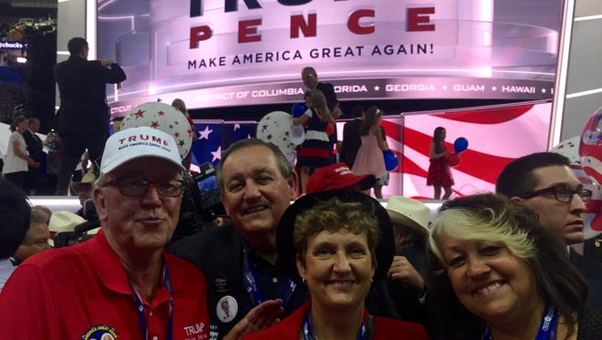 Robert Hayssen, John Prendergast, Sandy King and Susan McNeil pose in front of the stage after the Republican National Convention wrapped up in Cleveland late Thursday. The New York delegates staked out first-row seats each night of the convention.