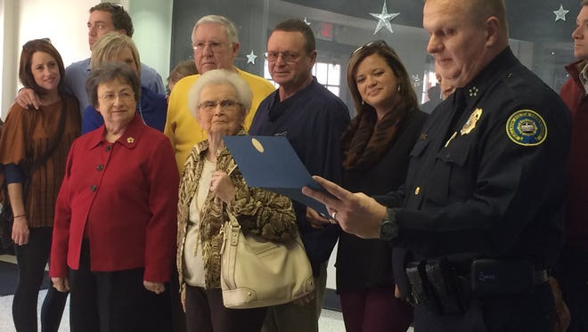 """In this file photo, Gallatin Police Chief Don Bandy, right, reads a certificate honoring Dr. Jerry McMillan (back row, center right) and his actions to save James """"Hack"""" Gillum (back row, center left) during a Nov. 24 Lions Club meeting."""