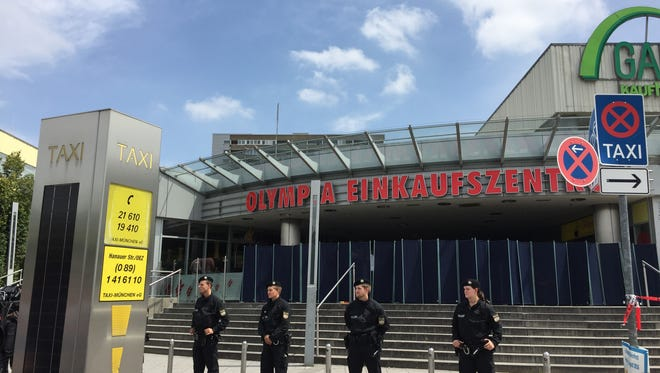 Munich police stand guard outside the shopping mall that was attacked on July 22.