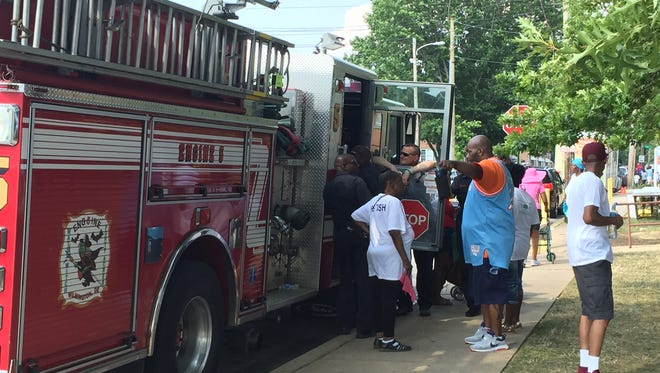 Wilmington Fire Department firefighters talk to kids at the Kingswood Community Center Day event.
