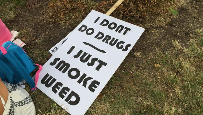 This sign got displayed during a pro-legalization rally.