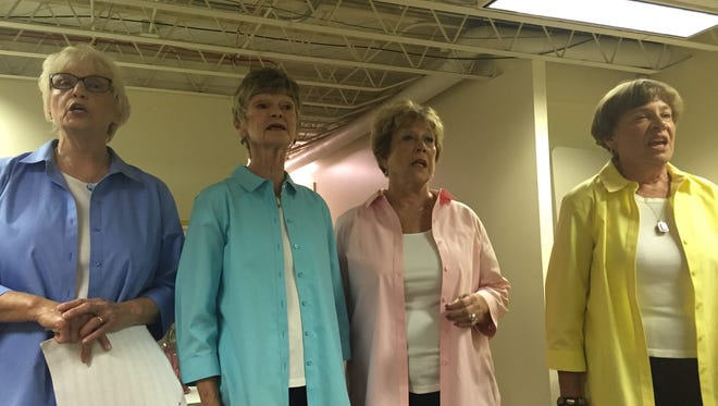 The barbershop quartet, The Grammatones, perform Monday at the Ohio Glass Museum in Lancaster. The Grammatones are (left to right) Anne Hart Kiphen, Jo Ann Schosek, Barbara Curtiss Stiles and Suzanne Culver.