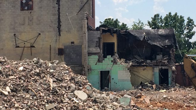 Portions of the Bransford Youth Community Center bathrooms came down along with the demolition of the old Bransford High School gym last week, leading to a possible condemnation of the bathrooms and displacement of the center's after school program this fall.