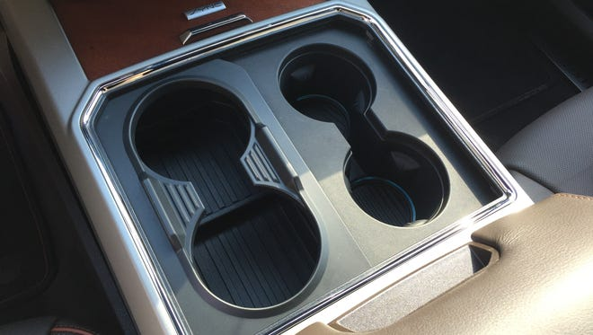 Ford Super Duty has cool cupholders that convert from two to four between the front seats