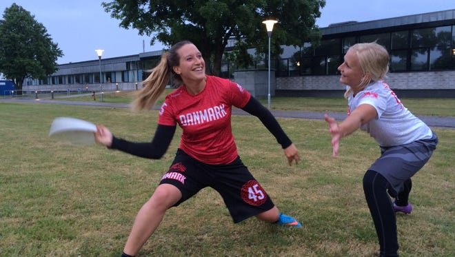 Stephanie Neumeier, left, practices with a teammate on the Denmark mixed national team. Neumeier, a 2009 Bay Port graduate, played in the World Flying Disc Federation's World Ultimate Championships last month in London.