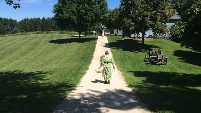 A volunteer at Pinecrest Village walks along a path that could very easily be mistaken as Walnut Grove.