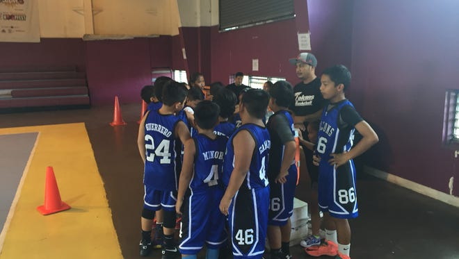 The MTM Falcons huddle up during a time-out. The Falcons defeated the Tamuning Typhoons II 32-10 in the SummerJam basketball tournament 10-and-under coed division Sunday, July 31 at Tamuning gym.
