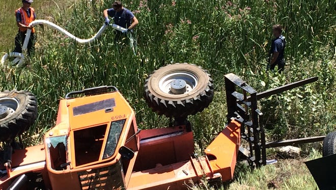 A forklift fell off a trailer into a waterway at Cathy Fromme Prairie Natural Area on Monday.