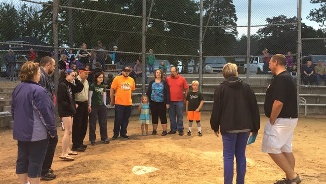 Beverly Aschenbrenner's family being honored after a little league softball game on Thursday,  July 28. 2016.