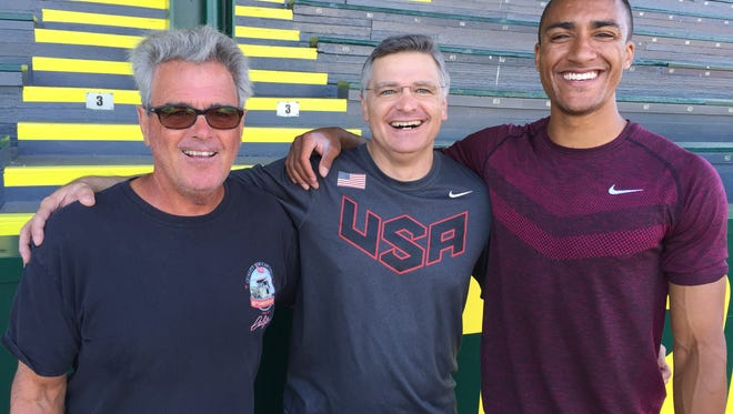 Harry Marra, Ashton Eaton's coach, Curt Draeger, Antigo-area chiropractor who treats Eaton, and Eaton all pose for a snapshot.