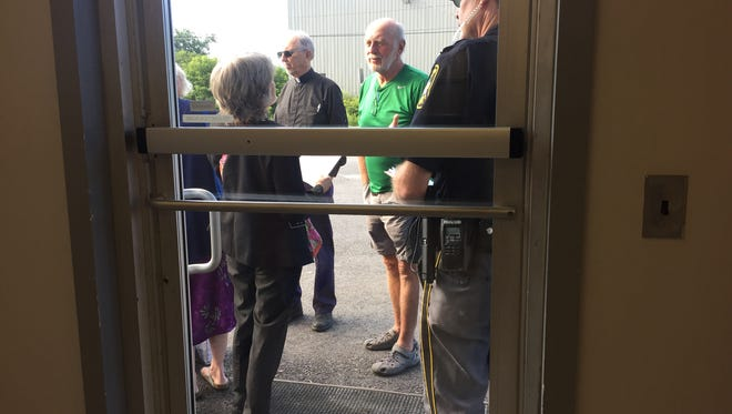Security checks a list for people cleared to attend the Aug. 4, 2016, Public Service Board hearing in Berlin to determine Vermont Gas Systems, Inc., right of way through Geprags Park in Hinesburg. According to an order from the board, six members of the general public will be allowed in.