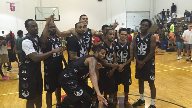 The 2016 Moneyball Pro-Am champion Black team, including MSU's Josh Langford (left), MSU's Gavin Schilling, former Kalamazoo Central and Dayton standout Devin Oliver (front bottom) and former Everett and Oakland star Derick Nelson (behind Oliver).