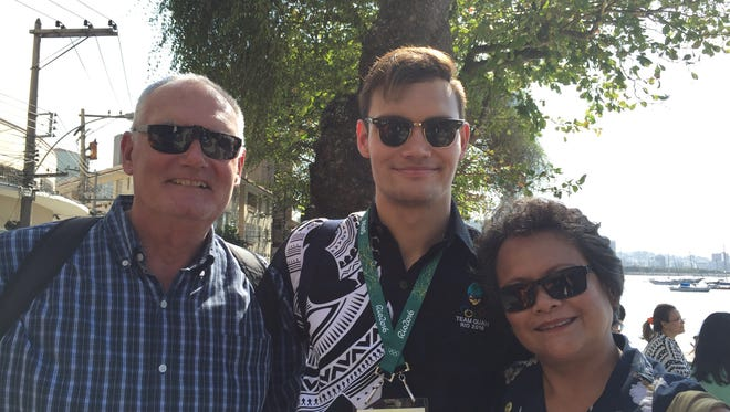 Greg and Lou Schulte take a photo with their son Benjamin Schulte on Aug. 4 near Urca Beach, in Rio de Janeiro. The proud parents will cheer for their son during his 100-meter breaststroke event on Saturday.